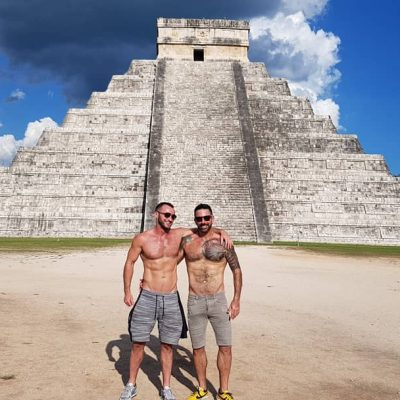2 guys at base of Chichen Itza