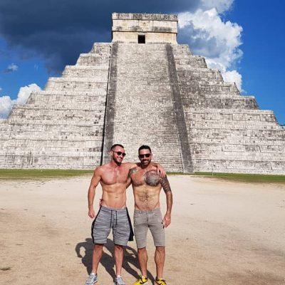 2 guys at base of Chichen Itza