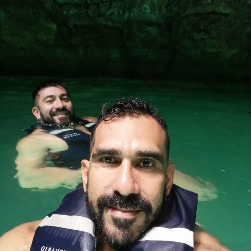 Guys Swimming Cenote Tsukan